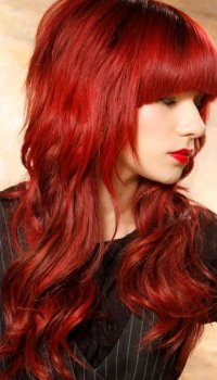 long-wavy-cut-red-hair-bangs-view-2